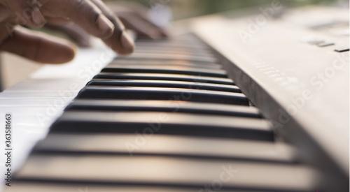 Fotografie, Obraz Close-up Of Hand Over Piano Keys