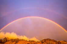 Low Angle View Of Rainbow Against Sky During Sunset