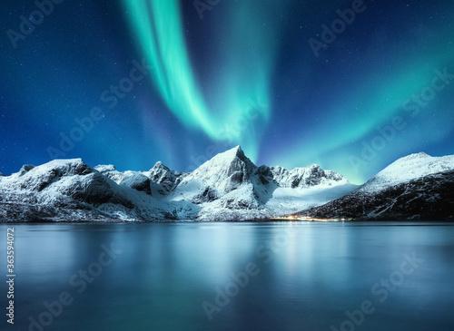 Fototapeta Aurora Borealis, Lofoten islands, Norway. Northen lights, mountains and reflection on the water. Winter landscape during polar lights. Norway travel - image obraz