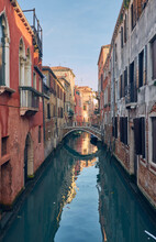 Canal In Venice Italy Red Wall