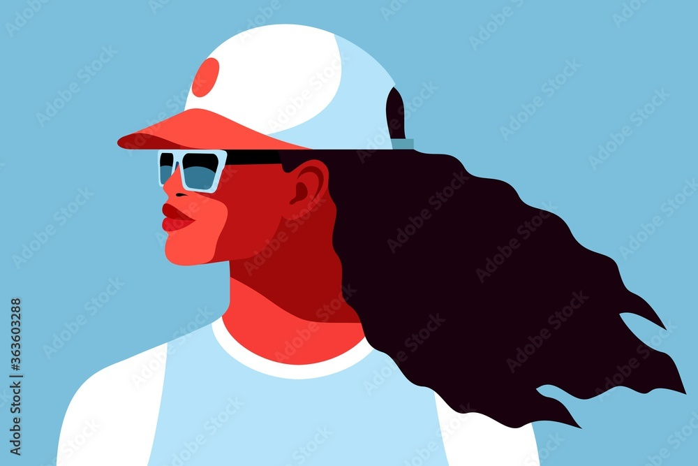 Fototapeta Young african woman wearing t-shirt, baseball cap and sunglasses. Abstract fmale portrait, side view