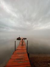 Boy On Foggy Dock