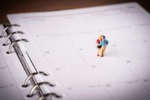 High Angle View Of Figurine On Calendar