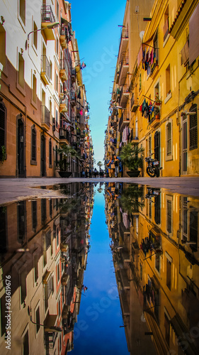 Fotografie, Obraz Reflection Of Buildings In Puddle