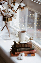 High Angle View Of Coffee With Books On Window Sill