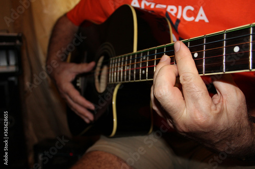 Stampa su Tela The fretboard of an old acoustic guitar