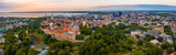Fototapeta Uliczki - Tallinn is a medieval city in Estonia in the Baltics. Aerial view of the old town of Tallinn with orange roofs and narrow streets below.