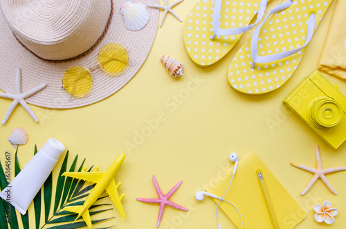 Fototapeta Summer holiday Vacation border frame mockup. Top view beach accessories on a yellow background. Copy space obraz