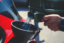 Process Of Refueling The Sportcar Tank With Gasoline From Canister During Test-drive Racing Competition Event