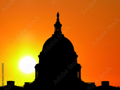 United States capitol building dome silhouette with sunset sky. #363651635
