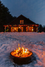 Fire Pit In Vermont With Winter Christmas Lights