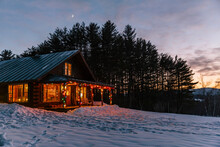 Log Cabin In New England With Winter Christmas Moonlight