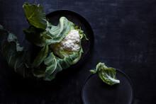 Raw Cauliflower On A Dark Back...