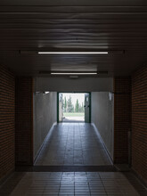 Dark Hallway With Exit To Street