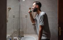 Bearded Man Brushing Teeth In ...