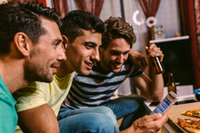 Friends Watching A Soccer Match At Home