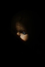 Close Up Of A Vintage Baby Doll, In The Shadow