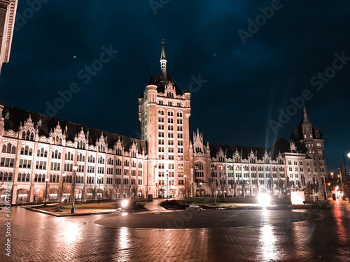 Obraz na plátne Reflection Of Illuminated Buildings In City At Night