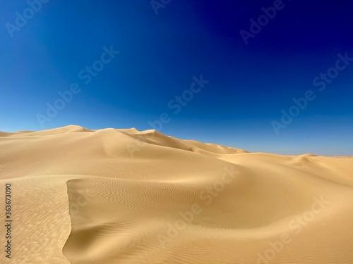 Billede på lærred Sand Dunes In Desert Against Clear Blue Sky