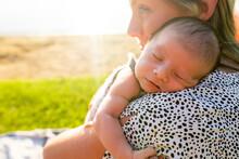 Newborn Baby Sleeping On Mothe...
