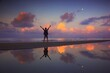 canvas print picture - Silhouette Man Standing In Sea Against Sky During Sunset