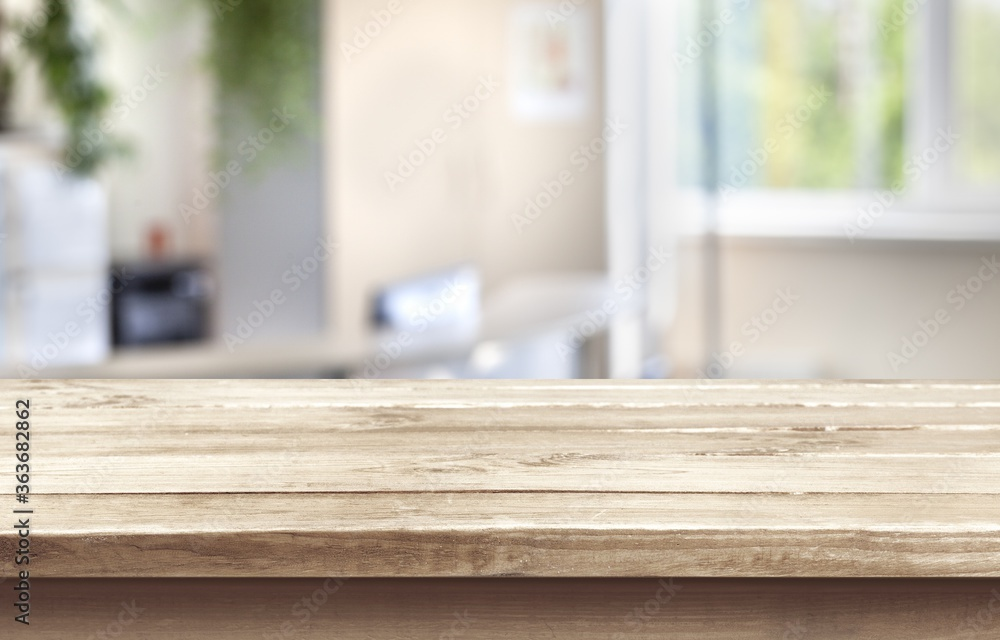 Fototapeta Wooden empty table top on blur background