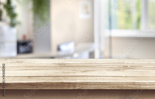 Wooden empty table top on blur background