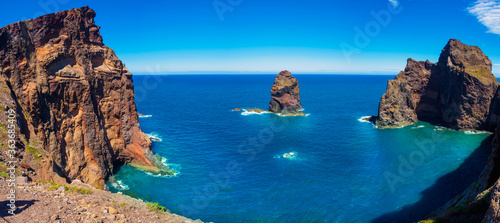 Fototapeta Aerial panoramic view of the ocean scape and mountain cliffs in Ponta de Sao shore in Madeira island, Portugal obraz