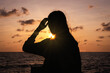 Silhouette Woman By Sea Against Sky During Sunset