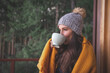 Leinwandbild Motiv Woman Wearing Warm Clothing Drinking Coffee