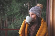 Woman Wearing Warm Clothing Drinking Coffee