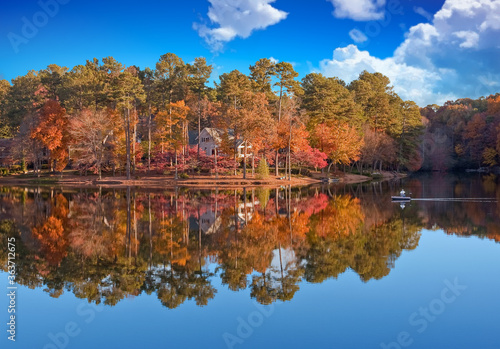Fotografie, Obraz Reflection Of Trees In Lake Against Sky During Autumn