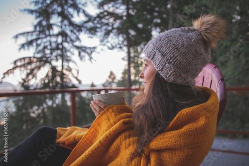 Side View Of Woman Wearing Warm Clothing Having Coffee Outdoors Fotobehang