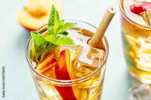 Fototapeta Iced tea with peach and ice cubes obraz