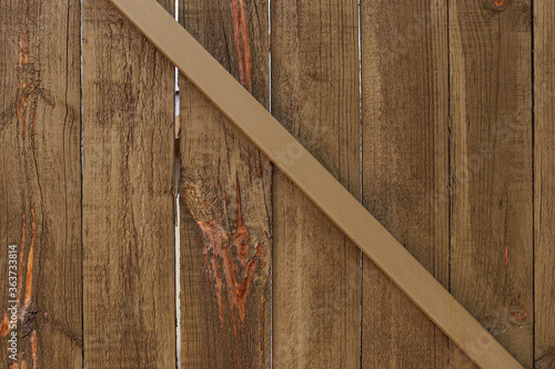 Fototapeta textured wooden paling fence with cross strut background