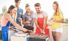 Happy Friends Preparing Food On Barbecue