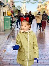 Girl Wearing Warm Clothing Standing On Street