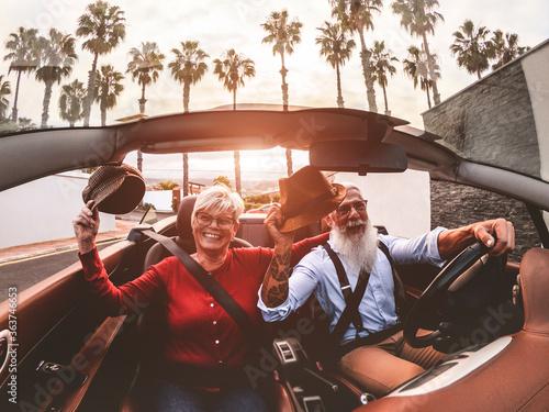 Obraz na plátne Senior Man With Woman Driving Car