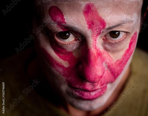 Close-up Portrait Of Man With Face Paint