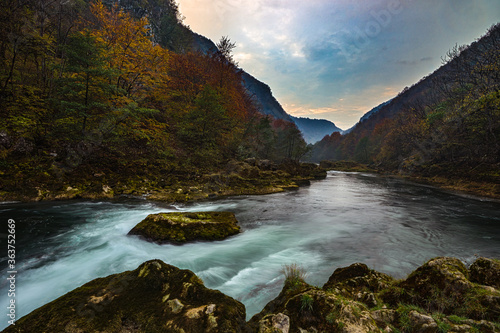 Fotografie, Obraz Scenic View Of River Amidst Mountains Against Sky