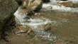 Slow Motion of Crystal Clear Water Swishing Joyfully over the Rocks