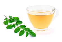 Glass Cup Of Moringa Tea With Green Leaf Isolated On White Background.