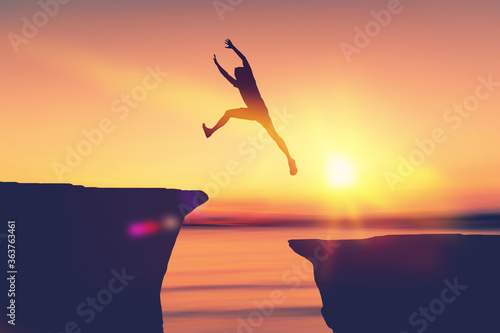 Silhouette man jumping between cliff at tropical sunset beach. Slika na platnu