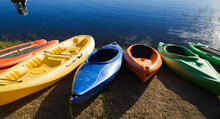 Colorful Kayaks By The Lakeside
