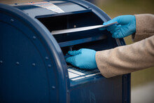 Close Up Of A Person Mailing A Letter