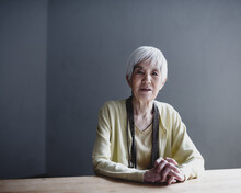 Portrait Of Senior Woman Sitti...