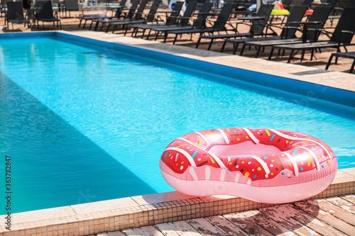 Fototapeta Inflatable ring on the edge of swimming pool obraz