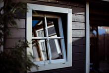 Close-up Of Window Of Wooden Garden House