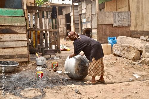 Full Length Of Woman Washing Utensil Canvas Print