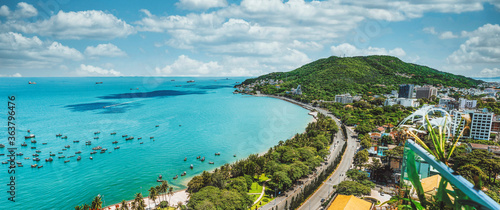 Obraz Panoramic coastal Vung Tau view from above, with waves, coastline, streets, coconut trees and Tao Phung mountain - fototapety do salonu